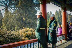 BEIJING, CHINA - 29 JANUARY, 2017: Guards wearing green uniform coats inside temple of heaven, imperial complex various Stock Photos