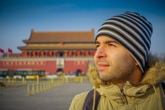 BEIJING, CHINA - 29 JANUARY, 2017: Hispanic tourist on Tianmen square looking around, famous forbidden city building in. Background, beautiful blue sky Stock Image