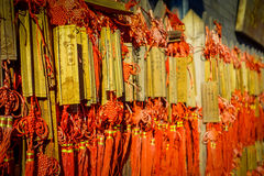 BEIJING, CHINA - 29 JANUARY, 2017: Hundreds of small wooden message plates with red rope, traditional buddhism ornaments. Located at Juyong great wall site Stock Photo