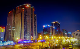 BEIJING, CHINA - 29 JANUARY, 2017: Metropolitan chinese capitol, large office buildings and charming street lights on a. Beautiful dark evening Royalty Free Stock Image