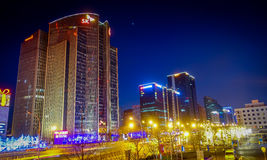 BEIJING, CHINA - 29 JANUARY, 2017: Metropolitan chinese capitol, large office buildings and charming street lights on a. Beautiful dark evening Royalty Free Stock Images