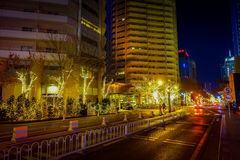 BEIJING, CHINA - 29 JANUARY, 2017: Metropolitan chinese capitol, large office buildings and charming street lights on a. Beautiful dark evening Royalty Free Stock Photography
