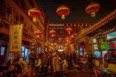 BEIJING, CHINA - 29 JANUARY, 2017: People walking around charming streets with small restaurants, traditional Stock Photography