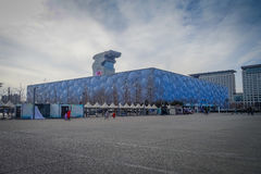 BEIJING, CHINA - 29 JANUARY, 2017: Walking around modern olympic sports center looking at different arenas, nice blue. Sky Royalty Free Stock Images