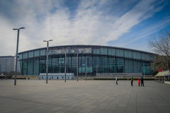 BEIJING, CHINA - 29 JANUARY, 2017: Walking around modern olympic sports center looking at different arenas, nice blue. Sky Royalty Free Stock Photo