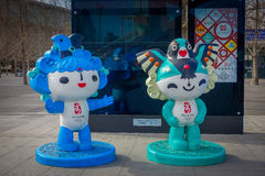 BEIJING, CHINA - 29 JANUARY, 2017: Walking around modern olympic sports center looking at different arenas, offical. Mascot models standing around Stock Photos