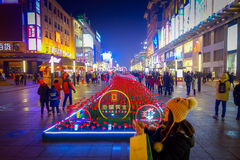 BEIJING, CHINA - 29 JANUARY, 2017: Walking on the famous pedestrian shopping street Wangfujing on a dark evening, busy Stock Image