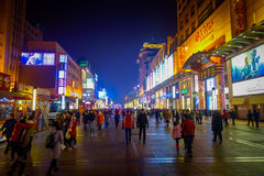 BEIJING, CHINA - 29 JANUARY, 2017: Walking on the famous pedestrian shopping street Wangfujing on a dark evening, busy Royalty Free Stock Photos