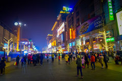 BEIJING, CHINA - 29 JANUARY, 2017: Walking on the famous pedestrian shopping street Wangfujing on a dark evening, busy Royalty Free Stock Images