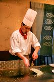 Beijing, China - June 9, 2018: Chinese chef is cooking dinner in front of the restaurant visitors. royalty free stock photo
