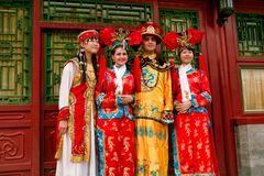Beijing China - June 7, 2018: Chinese tourists in national costumes are photographed at the pavilion in the Forbidden City. stock photo