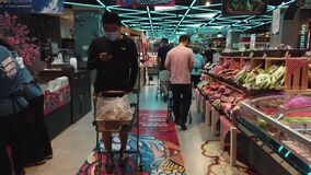 Beijing, China - 6June , 2020: Customers with masks shopping in supermarket in COVID19 pandemic, Beijing,China