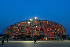 Beijing China Bird Nest National Stadium at night. Beijing, CHINA - 22 MAR, 2018: Beijing National Stadium also known as the Bird Nest at dusk Royalty Free Stock Images