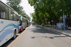 BEIJING, CHINA - MAY 22, 2016: Busses on crowded road close to W stock image