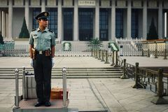 Chinese police officer at his guard post in front of the Mao mausoleum stock photos