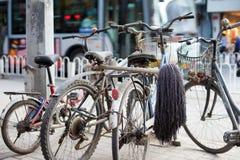 BEIJING, CHINA - MAY 12, 2013: Old bicycles at  a Beijing street Royalty Free Stock Photos