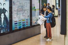 Poeple looking on map, Beijing, China. BEIJING, CHINA - MAY 09, 2016: Poeple looking on map in Beijing metro statation Stock Photo
