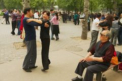 Chinese people dance in Jingshan Park in Beijing, China. Royalty Free Stock Image