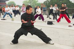 People practice tai chi chuan gymnastics in Beijing, China. BEIJING, CHINA - MAY 01, 2009: Unidentified people practice tai chi chuan gymnastics in Beijing Royalty Free Stock Photo