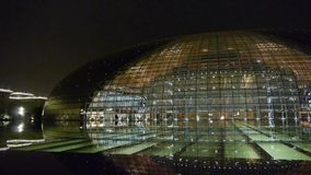 BeiJing China National Grand Theatre in reflection in lake water at evening night. stock video