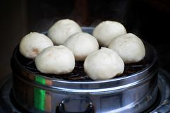 Chinese steamed buns, also known as baozi, waiting to be eaten. BEIJING, CHINA - NOV 12, 2013 - Chinese steamed buns, also known as baozi, waiting to be eaten royalty free stock images