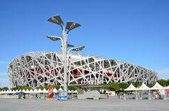 Beijing, China, October, 10, 2012. People walking near Bird's Nest in autumn day. The Bird's Nest is a stadium in Beijin Royalty Free Stock Photos