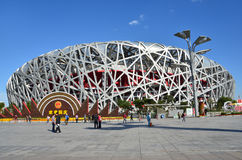 Beijing, China, October, 10, 2012. People walking near Bird's Nest in autumn day. The Bird's Nest is a stadium in Beijin Stock Image