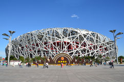 Beijing, China, October, 10, 2012. People walking near Bird's Nest in autumn day. The Bird's Nest is a stadium in Beijin. Beijing, China, people walking near Stock Photography