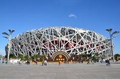 Beijing, China, October, 10, 2012. People walking near Bird's Nest in autumn day. The Bird's Nest is a stadium in Beijin Stock Photography