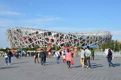 Beijing, China, October, 10, 2012. People walking near Bird's Nest in autumn day. The Bird's Nest is a stadium in Beijin. Beijing, China, people walking near Royalty Free Stock Images