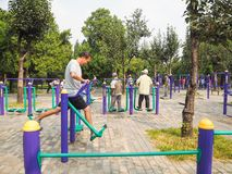 Beijing, china - September 2017: Elderly working out on public stock photography