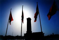 Beijing China, Tienanmen square. Back-light of the monument and flags in Tienanmen square royalty free stock photos