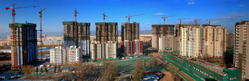 Beijing  Construction Site  Crane. Real estate is China's most important  industries now.House prices rose several times in  recent years.More and more houses Royalty Free Stock Image