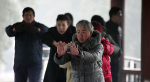 Beijing. Сhina - January 28, 2013: Group of Chinese practice Tai Chi in .Tai Chi Chuan is a martial art practiced for both self defense and health benefits Royalty Free Stock Image