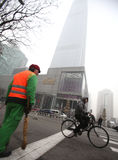 Beijing. Сhina - January 23, 2013: Man riding his bicycle in  on circa January 2013. Bicycle is the primary transportation for millions of Chinese Stock Photos