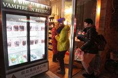 Beijing. Сhina - January 24, 2013: Woman entering store Vampire in  where morbid souvenirs can be found Royalty Free Stock Images
