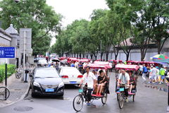Beijing Houhai`s manpower car. The rickshaw tour in Beijing, Houhai is a big landscape, red is gathering in crowds and groups, awning cloth, the driver from all Royalty Free Stock Image