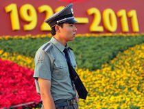 BEIJING - July 3: a soldier stands guard against the backdrop of Royalty Free Stock Photography