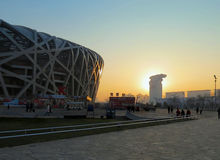 Beijing National Stadium (the Bird's Nest) at dusk. Beijing National Stadium (the Bird's Nest) at dusk with the sun Royalty Free Stock Images