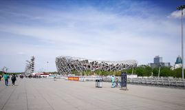 Beijing National Stadium BNS or Bird`s Nest Stadium, Beijing, China. BEIJING, CHINA - APRIL 15, 2017: Beijing National Stadium or Bird`s Nest Stadium. Tourists Stock Image