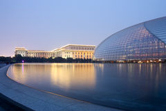 Beijing National Theatre. A shot of the National Grand Theatre, also known as Beijing National Center for the Performing Arts, at dawn, with Ren Min Da Hui Tang Stock Photos