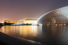 Beijing National Theatre. A shot of the National Grand Theatre, also known as Beijing National Center for the Performing Arts, at dawn, with Ren Min Da Hui Tang Royalty Free Stock Photos