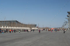 Beijing Olympic Park Square. Many tourists in Beijing Olympic Park Square Royalty Free Stock Photo