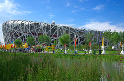 Beijing olympic stadium. Bird's Nest ,the national stadium with olympic torch in beijing Royalty Free Stock Photo