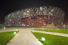 Beijing Olympic Stadium at Night. Beijing National Olympic Stadium also known as the Bird's Nest for its architecture. The stadium will host the main track and Royalty Free Stock Photos