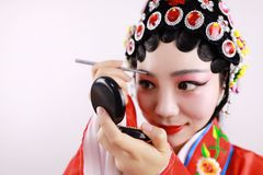 Close-up isolated white background Beijing opera Chinese female actress woman makeup traditional headwear costume drama portrait Stock Photo