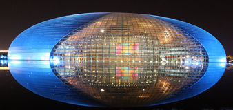 Beijing Opera House by night. The spectacular National Centre for the Performing Arts in Beijing, China, is one of the emblems of the new, modern, China stock photo