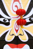Beijing Opera Mask. Red lanterns hang in front of the large Beijing Opera Mask Royalty Free Stock Photography