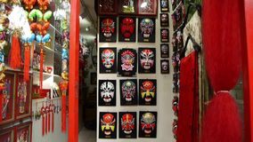 Beijing Opera mask on the store wall,chinese tradition art culture. stock video footage