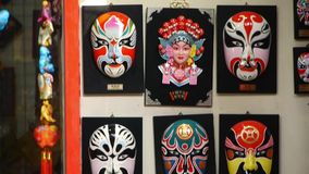 Beijing Opera mask on the wall,chinese tradition art culture. stock video